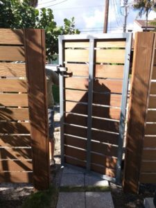 strong metal and wood fence and gate in broward