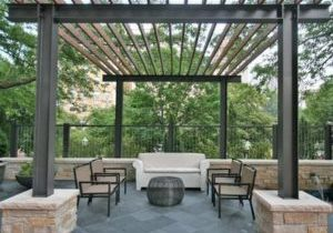 simple metal pergola with chairs and table